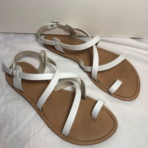 White strappy sandals with toe hole